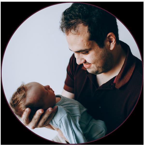 dad holding a newborn baby